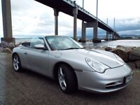 Porsche 911 Carrera convertible with hard top.