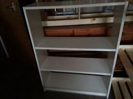 two racks of white and mahogany bookcases