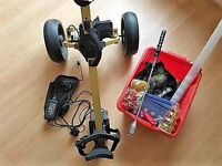 Electric golf trolley, balls, tees and grip aid