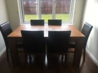 Brown dining table + 6 chairs