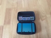 Teal Nintendo 3DS with case, charger and 4 games.