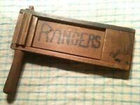 vintage football clacker ,stamped dated 1940s.