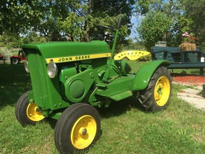 1965 refinished riding John Deere lawn tractor