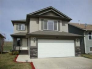 FOR SALE - N.E. AND N.W. CALGARY HOUSES WITH GARAGES