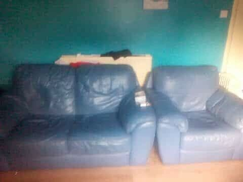 Blue leather sofa and chairs