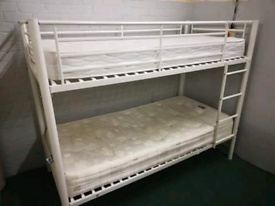 White bunk beds with Mattresses