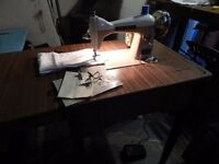 electric heavy duty sewing machine in table