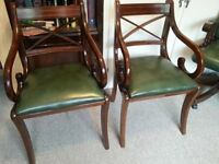 2 dark wood green leather chairs