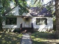 CHARACTER 3-BDRM BUNGALOW WITH DBL DETACHED GARAGE IN MCKERNAN