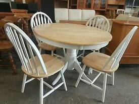 Round table and 4 white painted chairs