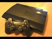 PS3 Super Slim 12GB Games Console with two controllers