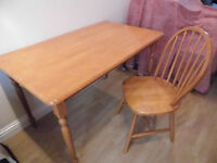 Good size, wooden, four place setting dining table and chairs
