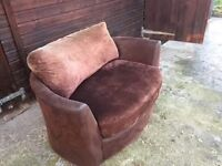 Brown suade swivel/cuddle chair