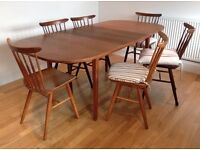 Antique hardwood dining table with 8 chairs - removable leaf