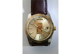 gents Credit Suisse Ingot watch .999 gold, with day and date aperture present