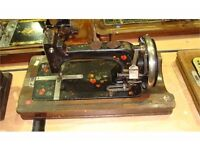 Collectible antique J.D Williams hand cranked sewing machine