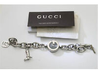ladies Gucci G watch charm bracelet model 107 with attached charms including a boot