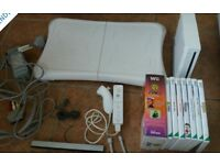 Wii console + controllers + fit board + 7 games