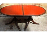 Very unusual dark wood extending table with red leather inset