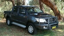 2012 Toyota Hilux KUN26R MY12 SR Double Cab White 5 Speed Manual Utility Oaks Estate Queanbeyan Area Preview