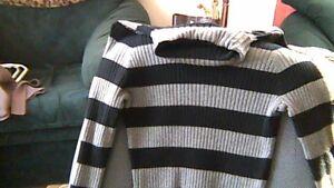 long waisted turtleneck sweater..size Large