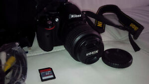 Nikon D5100 Camera with 18-55mm lens, case and SD card etc.