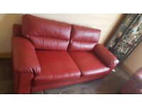 Red leather sofa. 2 years old. Collection only.