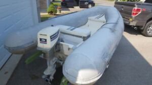 Caribe 13' boat with 15 HP Evinrude and trailer