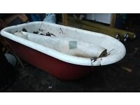 Cast iron bath with gold fittings