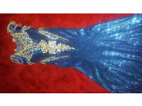 Navy blue sequin dress with small trail