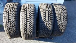 "Firestone ""Winterforce""  235/55R17 tires on rims"