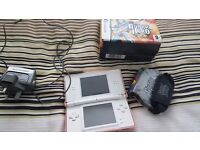 Nintendo ds with cartridge with multiple games and guitar hero handset