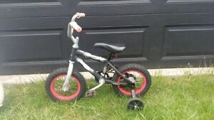 Boys Huffy Bmx with training wheels
