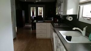 3 Bedroom Main Floor Apartment, Northside. Available March 1st.