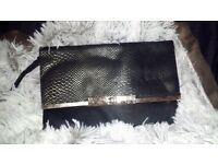 Large black and gold clutch bag