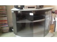 TV stand /table with two tinted glass doors closes with magnets