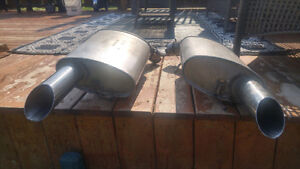 Two stainless steel stock mufflers.