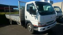 2005 Mitsubishi Canter FE659 4d34 White Truck 3.9l Wacol Brisbane South West Preview