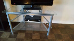 TV stand. silver with glass shelves $ 40 OBO