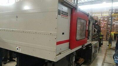 2003 310 ton Milacron MM310 High Speed, Wide Platen Packaging Machine