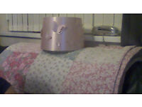 pink satin lampshade and patchwork bedspread with flowers on in pinks and duck egg blue