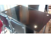 black glass table and 4 matching chairs in vgc