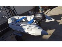 2.75 xm brig rib with 4hp suzuki 4 stroke on trailer