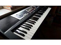 YAMAHA ypt-210 electronic keyboard.