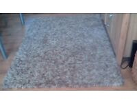 good quality rug with shaggy pile in cream and beige