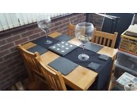 wooden dining table and 4 wooden/leather chairs for sale
