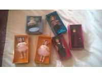 Collection of 6 small porcelain dolls