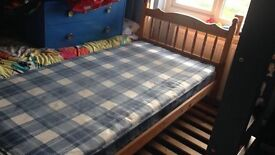 Pine single bed, with guest bed underneath