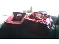 2 storage holders in burgundy ideal to store anything in.