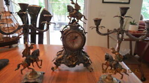 Brass clock and candle sticks